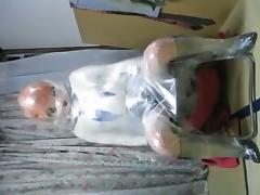 Kigurumi wrapped in plastic.