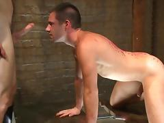 Gay couple enjoying BDSM porn