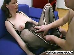 Lingerie-clad cougar with a hairy pussy enjoying a hardcore fuck