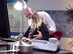 A curvy, busty secretary lets her boss hit it from behind