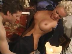 Blonde cougar with big fake tits enjoying an awesome doggy style fuck