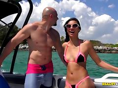 Brunette doll in sexy bikini getting hammered on a boat ride