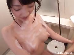 Soaping up a Japanese girl and playing with her sexy body