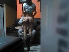 Brunette rides dong, while hidden cam films her