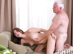 Young girl gives a blow to old rod