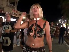 Ladies at Mardi Gras demonstrate their sexy body paint