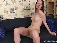 Babe removes g strings to toy pussy and ass on the couch