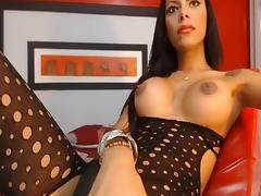 Colombian shemale in bodystocking jerking off her huge cock