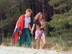 A sunbathing beauty meets a guy at the beach and fucks him