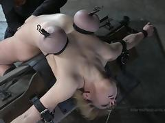Short-haired blonde with round hooters getting tortured in basement