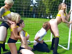 Dirty porn on the pitch with several cheerleaders