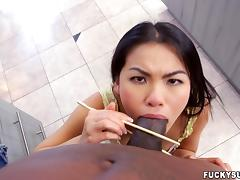 asian hottie goes sucky sucky on a big black penis