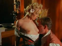 Vintage blonde model moans while taking a stiff one into herself