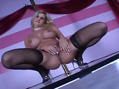Busty Blond Stripper Dances Around Pole
