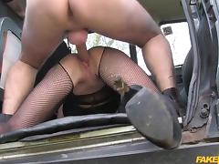 busty milf in fishnet fucked on the trunk of the taxi van