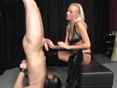 Chick in thigh high latex boots dominates him