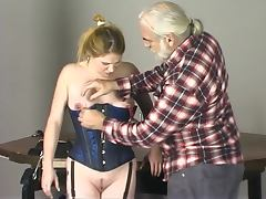 Cute young girl in corset has her nipples and pussy tortured by master