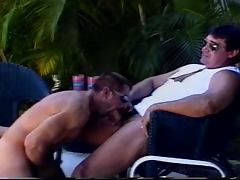 Buff gay daddies suck cock by the pool