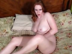 Busty redhead babe talks dirty while fucking