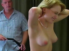 Slender babe gets spanked with force
