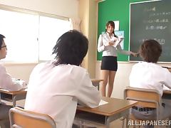 Lewd Japanese teacher Reo Saionji masturbates in a classroom