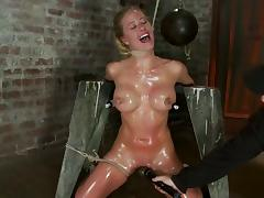 Nipple pumping in an oiled up bondage for Isis