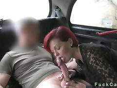 Redhead lady gets fucked added to creampie in fake taxi