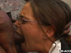 Long-haired milf gets brutally face-fucked by a black stud indoors