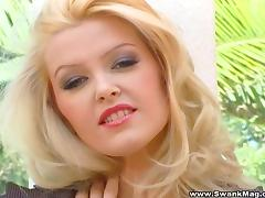 A stunning blonde fingers her nice pussy in a close-up video