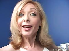 Mature blonde Nina Hartley gives BBC-sucking tutorial in gloryhole vid