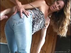 Delightful cougar in jeans giving her guy handjob until the gentleman cums